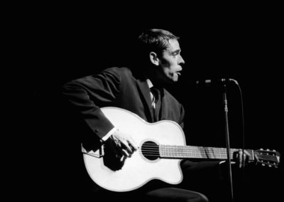 Jacques Brel performs at the Olympia in Paris, France in October , 1964